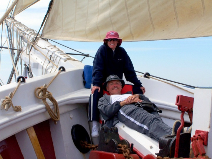 Relaxing on the foredeck of the Heritage at sea