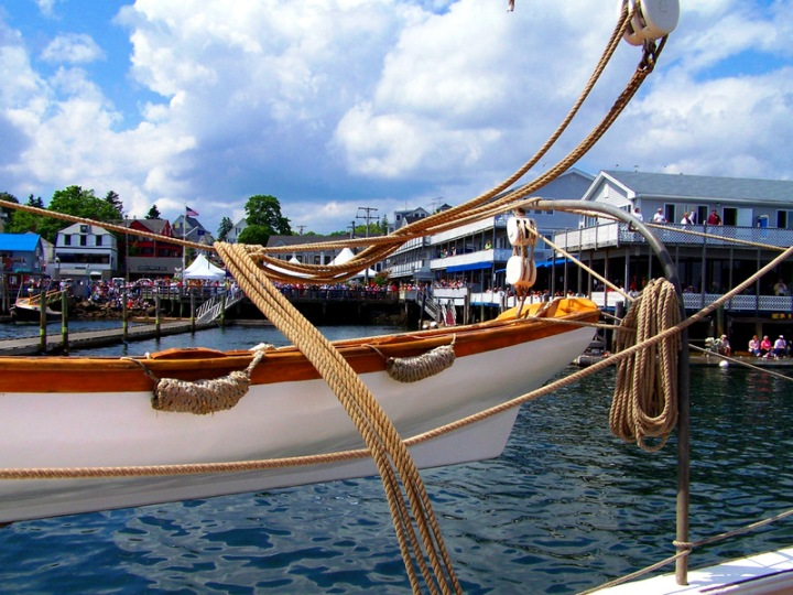 The crowd cheers the arrival of the Heritage in Boothbay Harbor